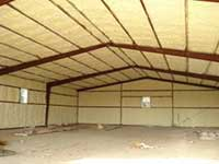 Operator insulating attic with Spray Foam